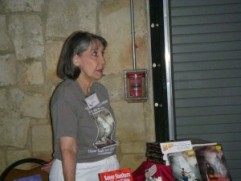 Joan Upton Hill discussing her books with an interested customer. Hill Country Book Festival 2011
